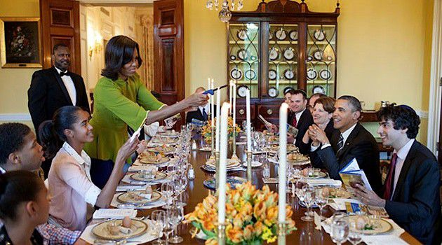 First Lady Michelle Obama lights candles to begin the 2012 White House Seder.