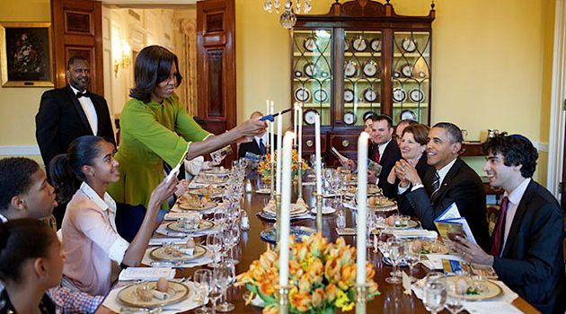 Welcoming Elijah: First Lady Michelle Obama lights candles to begin last year?s White House Seder. She and her husband will host another Seder this year on Monday night.