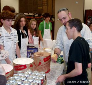 STAYING INVOLVED: Members of Explore a Mitzvah donate their time to serve up ice cream to people with developmental disabilities.