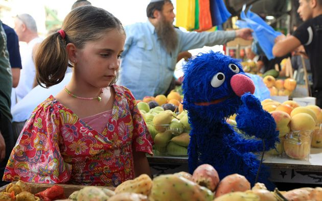 Grover in the Holy Land: The fuzzy, blue ?Sesame Street? character, Grover is in Israel to take part in TV shows that are attempting to get preschoolers there hooked on the message of Israeli-Arab coexistence