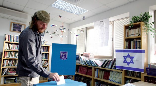 God On Their Side: A settler in Ofra casts his vote in the January 22 parliamentary elections.