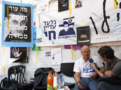 Making a Statement: Noam Shalit, left, the father of captured Israeli soldier Gilad Shalit, speaks with a journalist in a protest tent set up outside Prime Minister Ehud Olmert?s house.