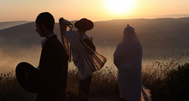 On the Mountain: Men praying on Mount Gerizim overlooking Joseph's Tomb on the eve of Shavuot.