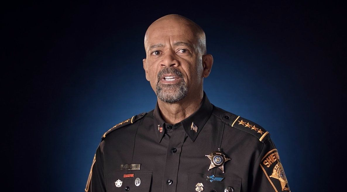 Milwaukee County Sheriff David Clarke wears the pin of Israel's National Traffic Police under his sheriff's badge in an NRA promotional video.