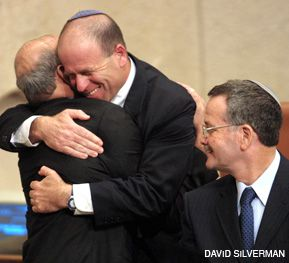 IN THE SHADOW OF SHARON: Avrum Burg, when he was Speaker of the Knesset during the Sharon era, hugs Salah Tarif, the first non-Jewish government minister. To their right, the Knesset secretary Aryeh Han, enjoys the moment.
