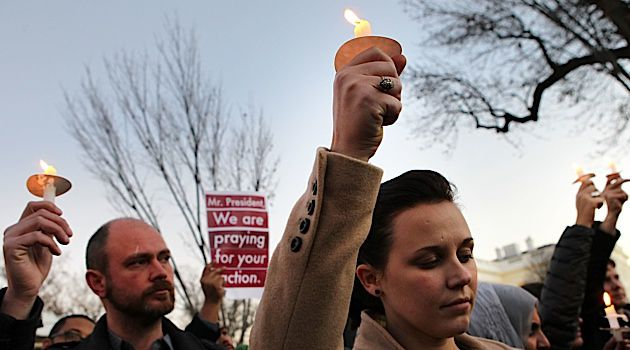 Honoring the Fallen: People gather outside the White House for a candle light vigil to remember the victims of the elementary school shooting in Connecticut.