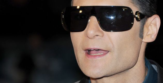 """Sunglasses at Night: No stranger to horror films himself, actor Corey Feldman dons a pair of dark shades for the world premiere of """"The Woman In Black"""" at the Royal Festival Hall in London."""