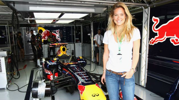 Fast Car, Pretty Girl: Model Bar Refaeli hangs out in the Red Bull Racing garage before the Brazilian Formula One Grand Prix at the Autodromo Jose Carlos Pace in Sao Paulo.