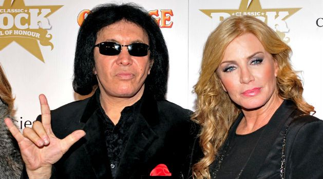 Rocker Salute: Former KISS frontman and Israel native Gene Simmons makes an entrance with his wife, Shannon Tweed, at The Classic Rock Roll Of Honour at The Roundhouse in London.
