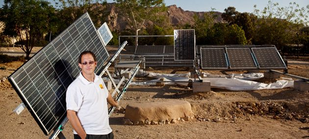 Zionism?s Eco-Frontier: Yosef Abramowitz, president of Arava Power, stands next to some of the panels that will be set up in the southern Negev at the company?s pioneering solar site.