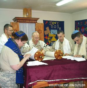IN TRAINING: Chaplain Jon Cutler (center) leads services for a group of soldiers at Al Asad airbase in western Iraq.