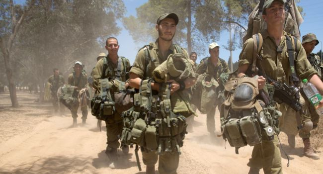 Heading In: Israeli soldiers on the Gaza border prepare for a ground invasion.