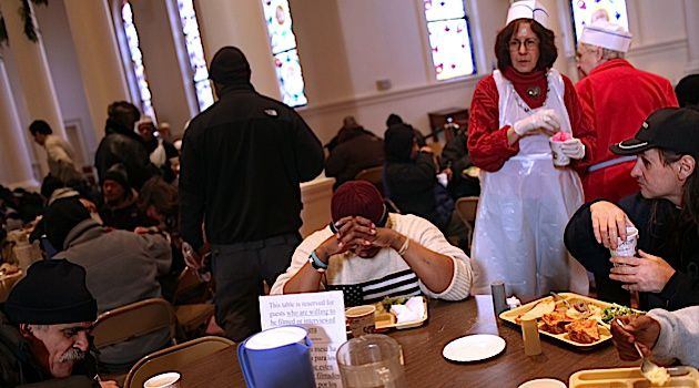Not Enough: Hungry New Yorkers gather for a meal in a soup kitchen, but countless Americans still go hungry every night.