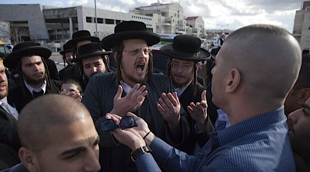 Culture Clash: Haredi protesters exchange angry words with more secular Israelis in the city of Beit Shemesh, December 26, 2011.