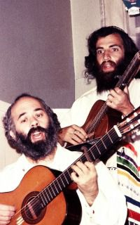 STRUMMIN? RABBI: Counter-culture Rabbi Shlomo Carlebach shares song with author Aryae Coopersmith.