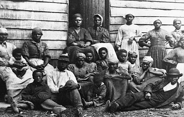 Exodus: ?Contrabands,? fugitive slaves emancipated upon reaching Union-controlled territory, sit outside a house, possibly in Freedman?s Village in Arlington, Va., in the mid-1860s.
