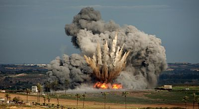 Still Reverberating: A bomb dropped from an Israeli plane explodes on January 3, 2009 during Operation Cast Lead in Gaza.