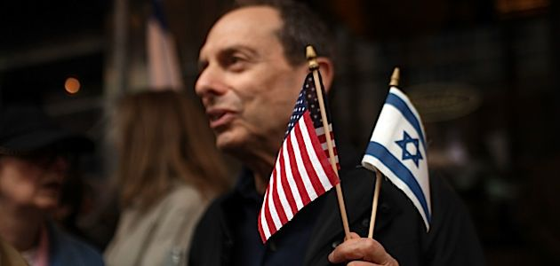 Irreconcilable?: A Jewish activist waves U.S. and Israeli flags during a protest in front of the Israeli Consulate to denounce a speech made by President Obama on May 20.