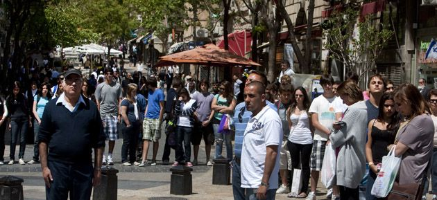 Silent Tribute: Israelis and tourists in Jerusalem observe two minutes of silence on May 9 as a siren wails across the country marking Remembrance Day for fallen Israeli soldiers.