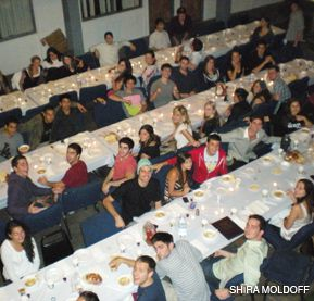 SMILE! IT'S FREE:: Students gather for a Friday night dinner at the University of Southern California, sponsored by the campus Hillel.
