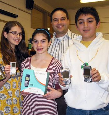 ?Voice of the Children?: Students at Milwaukee Jewish Day School sold their extra iPods and cellphones to raise money for a charity they formed. The students are, from left, Shoshana Farber, Jordan Salinsky and Avi Greenspan. Back row, teacher Brian King.