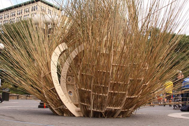 Porcuipine Quills?: Babak Bryan and Henry Grosman?s sukkah is built of marsh grass covering a circular plywood design.