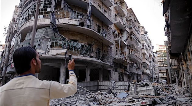 Devastation: As Syria?s civil war continues, a resident takes photos of destruction caused by aerial bombardment in city of Aleppo.
