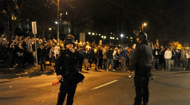 Standing With JoePa: Angry Penn State students battled police after the school?s board fired iconic football coach Joe Paterno. The school?s president, Graham Spanier, was also axed.