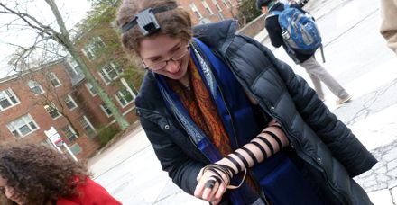 It Completes Her: Moses uses borrowed tefillin as part of her daily prayer practice.