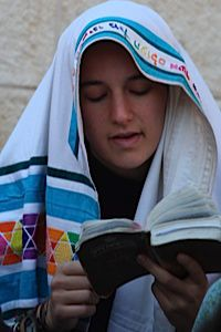 Wall Flower: A woman prays at the Western Wall in Jerusalem.