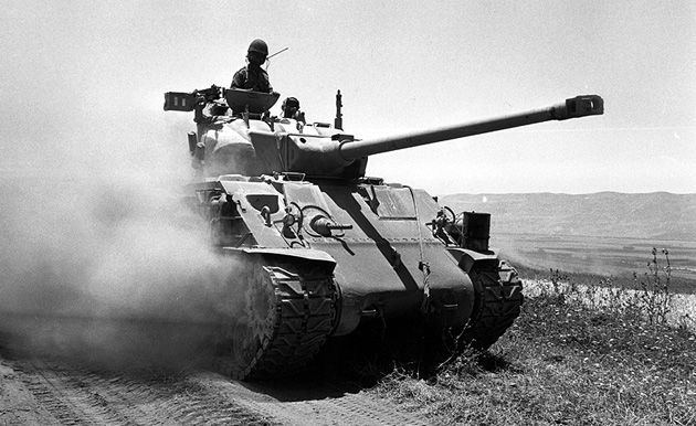 Defenders or Aggressors?: An Israeli tank advances into Syria during the Six Day War.