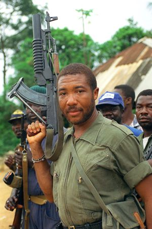 What Conversion? Former Liberian dictator Charles Taylor, shown here as a rebel leader headed toward the capital of Monrovia in 1990, has embraced Judaism, according to his wife, Victoria.