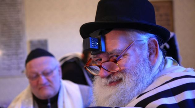 Worshipful: A member of the Teleki Square congregation prays in a tallis and tefillin.