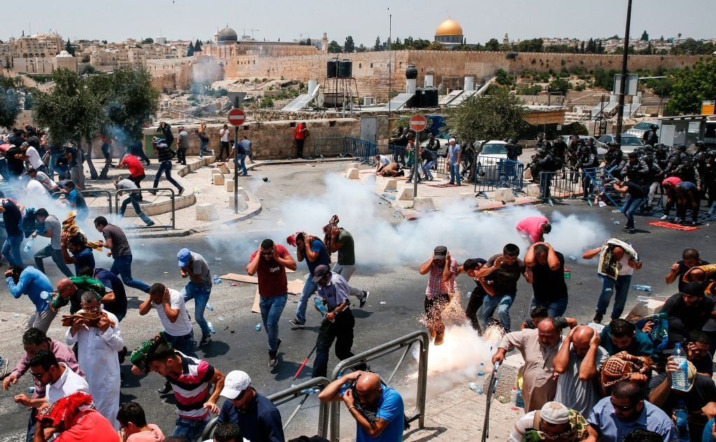 Palestinians outside the Old City of Jerusalem were dispersed by tear gas. Worshippers had been praying, protesting and in some cases rioting outside the Temple Mount due to a boycott called after Israel placed metal detectors at the entrance to the holy site following an attack on the Mount that killed two Israeli policemen.