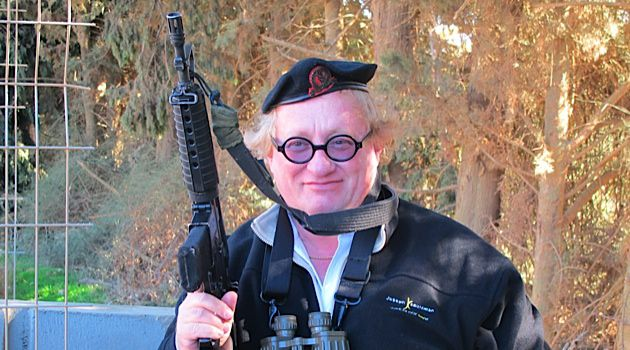 Taking Aim at a Stereotype: Tuvia Tenenbom poses with his interview subject?s assault rifle.