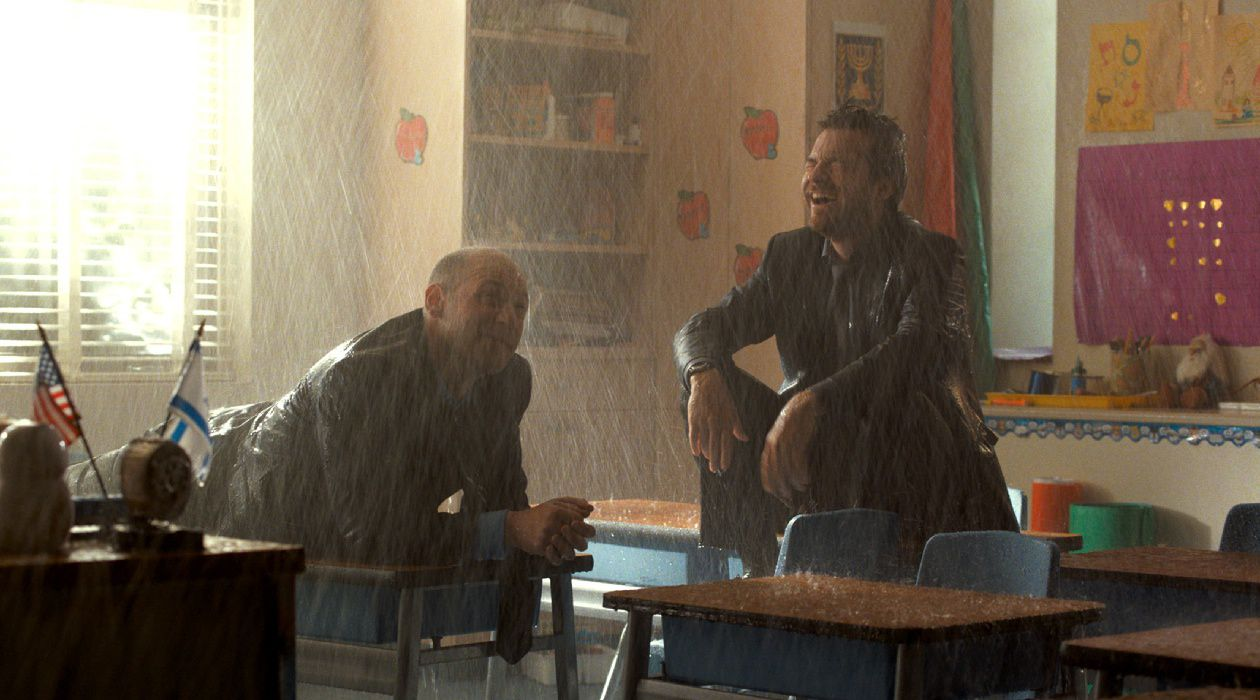 Let It Come Down: Corey Stoll and Jason Bateman set off the sprinkler system in 'This Is Where I Leave You.'