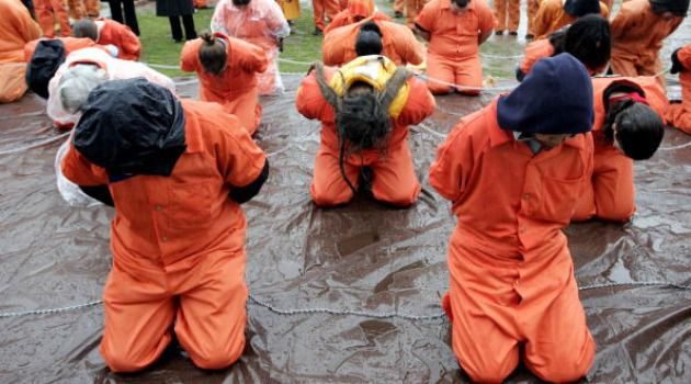 Protest:  Members of the organization Witness Against Torture highlight harsh techniques in a Washington demonstration in 2012.