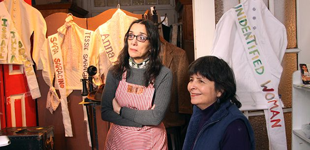 Honoring a Memory: Performance artist Lulu Lolo (left) and Suzanne Pred Bass look over the handiwork of freshly created blouses and sashes created in memory of the victims of the 1911 fire.