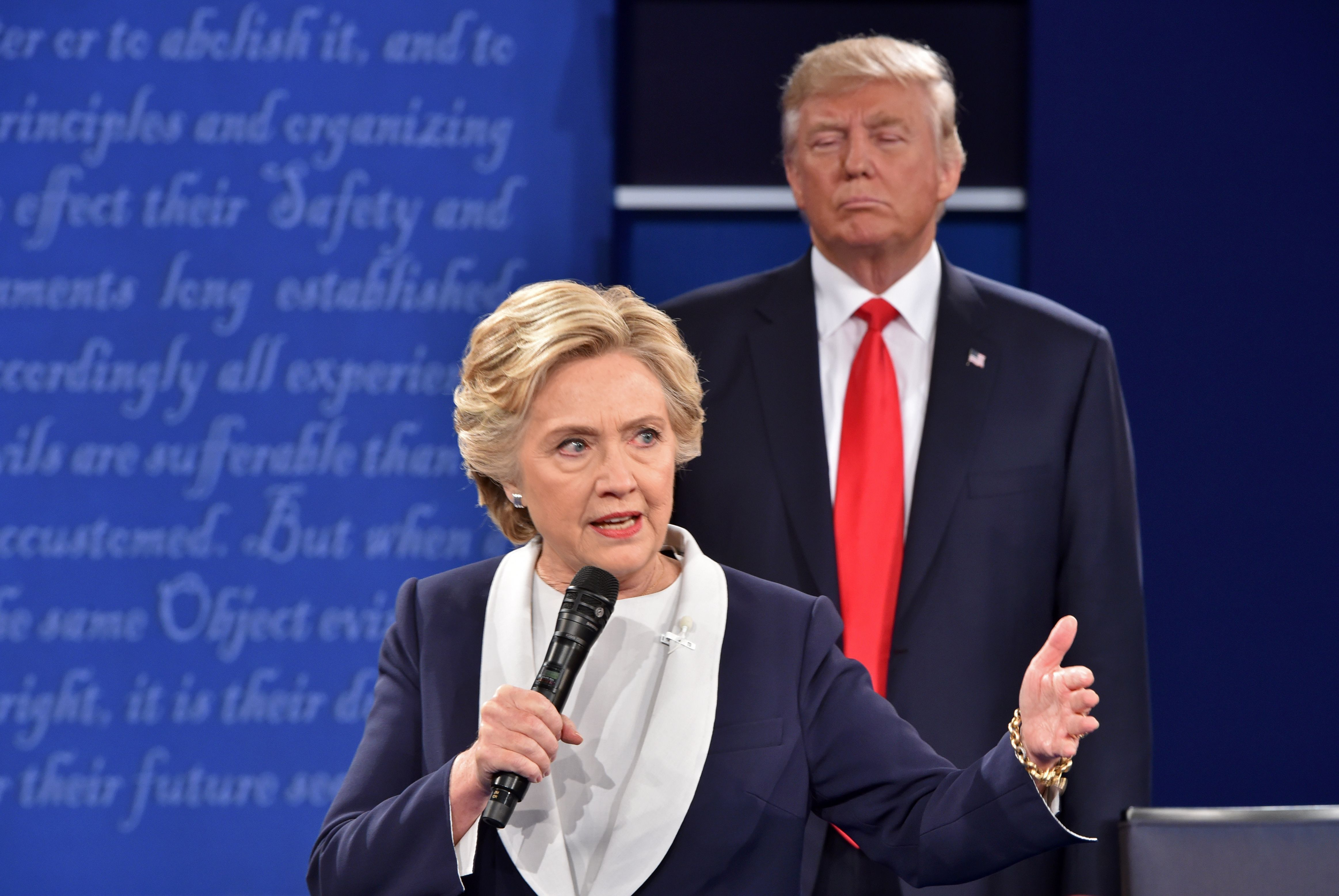 Trump observes Clinton during the second presidential debate.