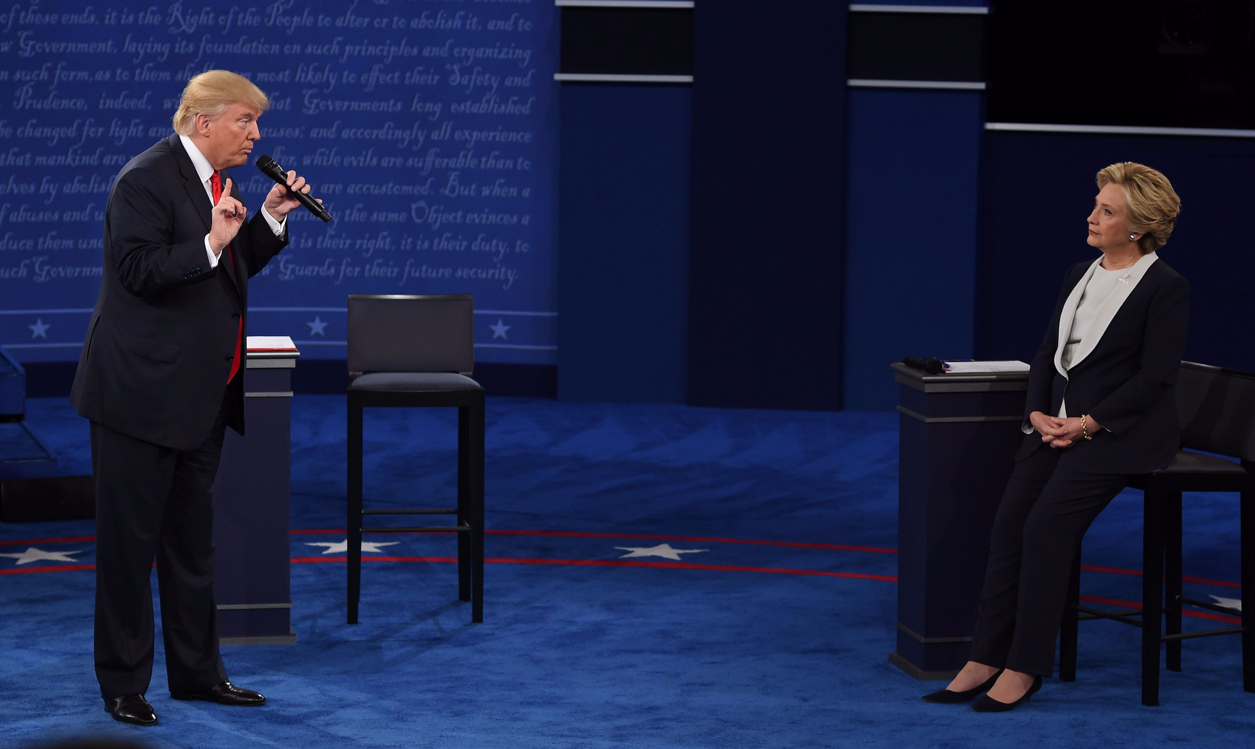 Trump stands above Clinton during the second presidential debate.