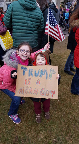 Rachel Goldbergs children at a rally in Boston after the initial immigration ban.