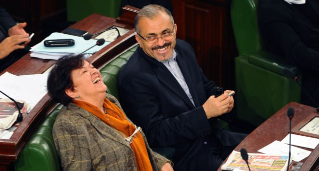 Equality: Tunisian Ennahda?s executive board member Amer Larayedh (right) laughs with leftist MP Selma Baccar (left) during a session at the National Constituent Assembly on January 8 in Tunis.