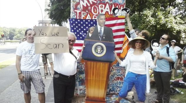 Alone Among Germans: Author Tuvia Tenenbom (holding sign) takes part in a small demonstration just a few blocks away from Barack Obama?s speech at Brandenburg Tor.