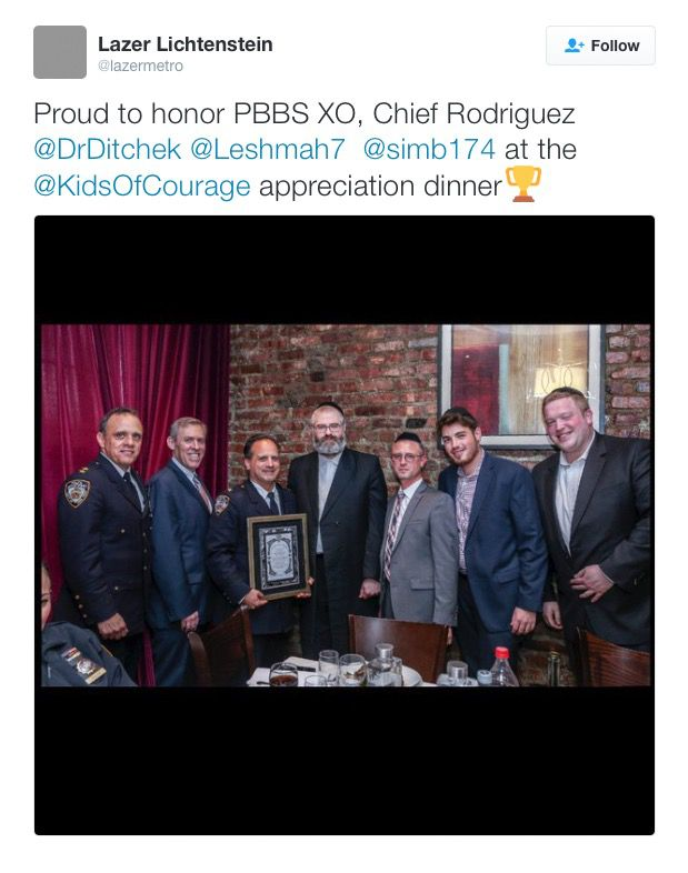An attendee at the Kids of Courage dinner at The Loft tweeted a picture from the meal of Simcha Bernath, center, with Assistant Chief Steven M. Powers, far left, among others.