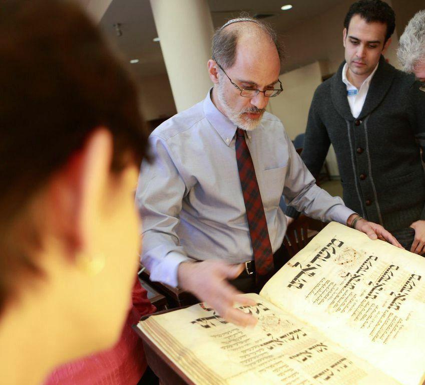 Ancient Texts: Librarian David Kraemer examines a volume in the Jewish Theological Seminary's rare book room.