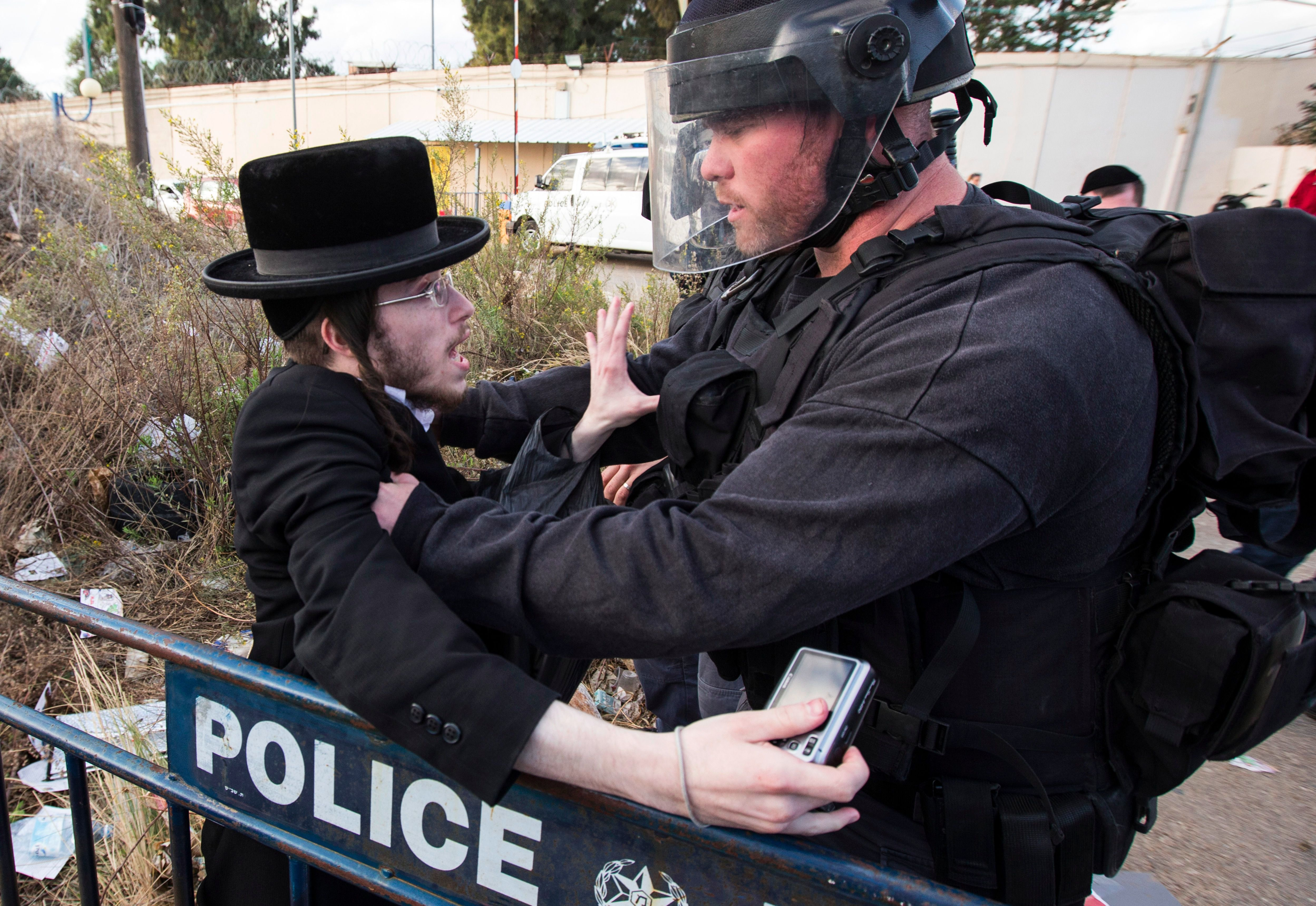 A confrontation between an ultra-Orthodox protester and an Israeli policeman during a 2013 protest over the arrest of a man who refused military service.