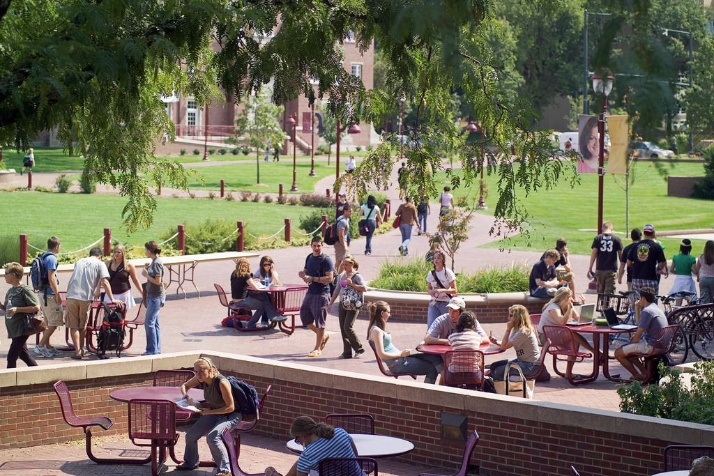 Students sit at tables at the University of Denver.