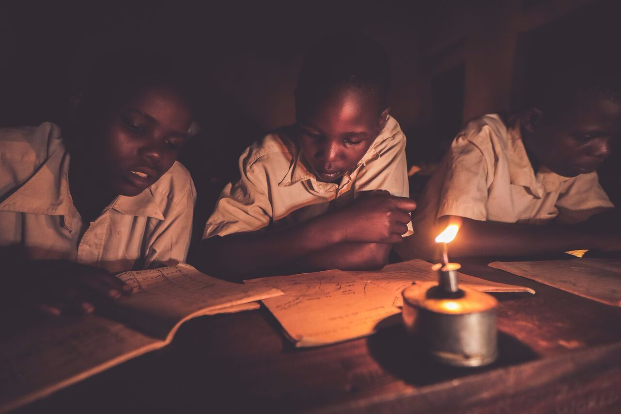 Many remote villages in Uganda lack electricity.