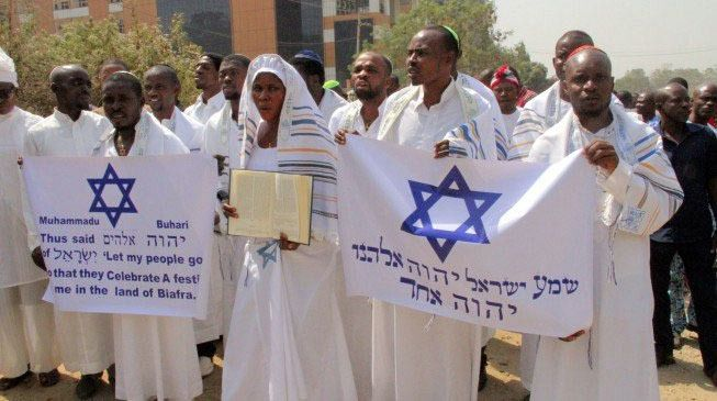 Demonstrators, dressed in Jewish garb, rallied on behalf of a jailed Biafran, carrying signs in Hebrew and English.