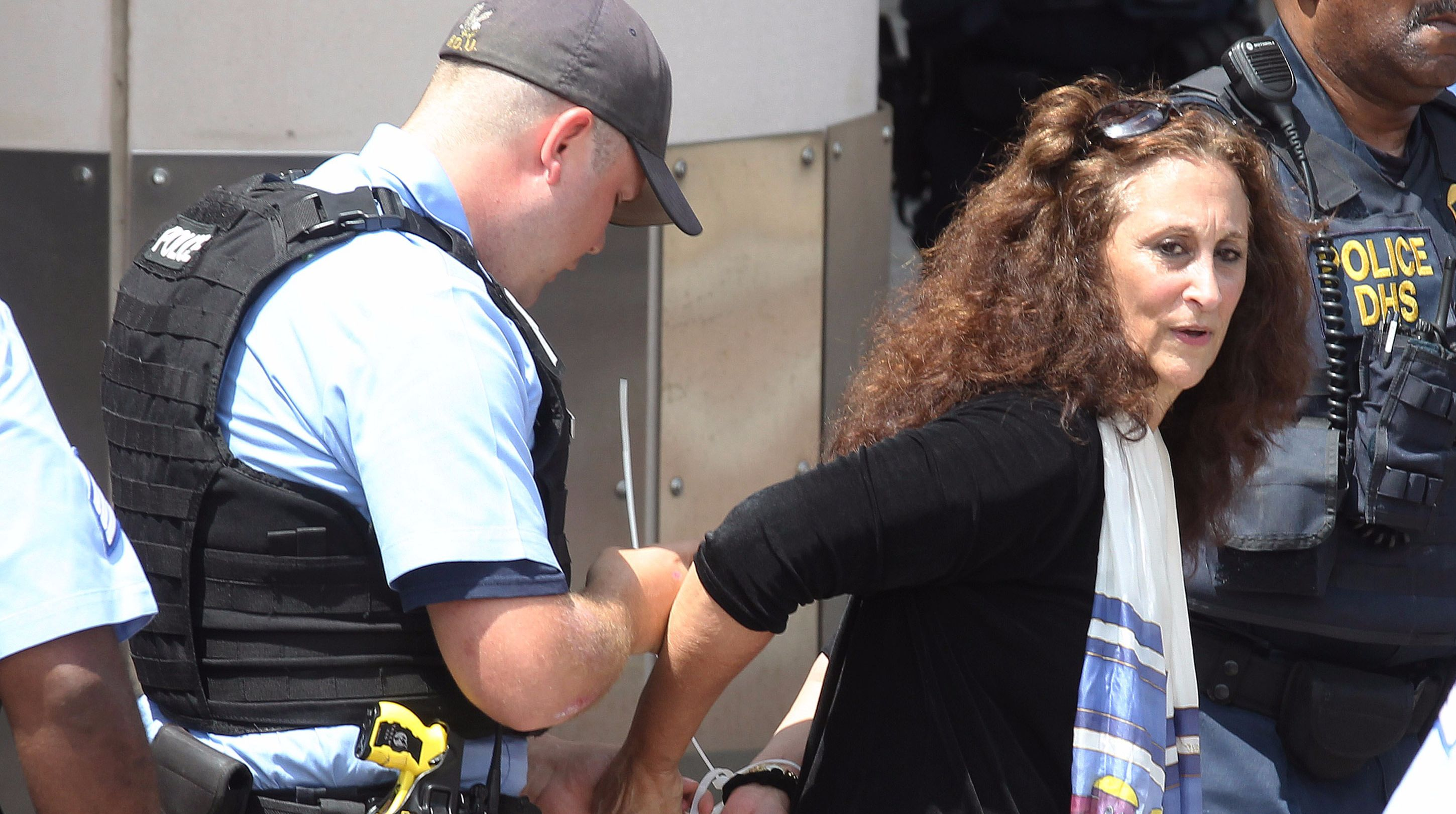 Rabbi Susan Talve is arrested in St. Louis as part of a day of disobedience held on the one-year anniversary of Michael Brown Jr.'s shooting death.